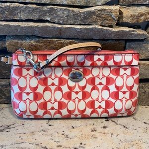 Large pink and white coach wristlet